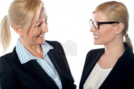 Photo for Businesswomen meeting and discussing company's progress - Royalty Free Image