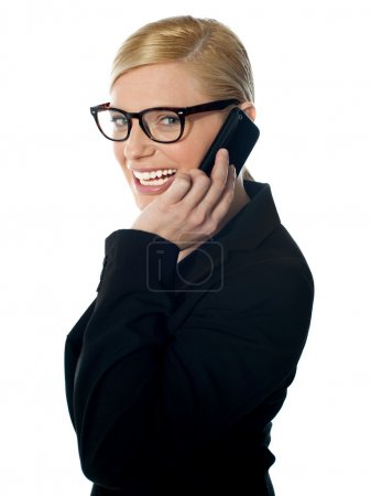 Photo for Side view of a female manager attending phone call isolated on white - Royalty Free Image