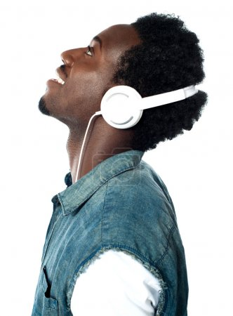 A handsome young boy listening to music on his mp3...