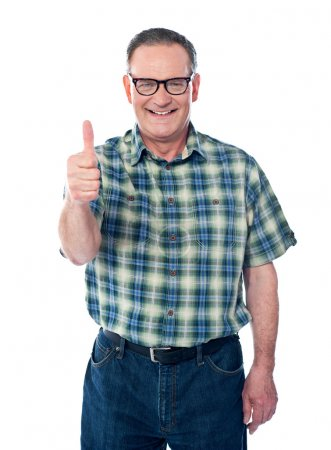 Casual old man showing thumbs-up sign to camera