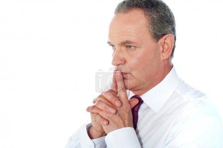 Portrait of thoughtful businessman