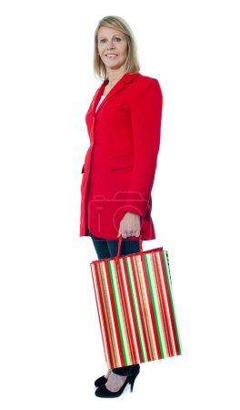 Beautiful senior lady holding shopping bag
