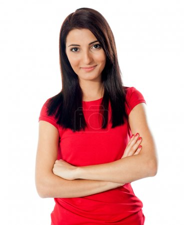 Photo for Pretty teenager posing with folded arms, smiling in front of camera - Royalty Free Image