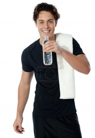 Fit man drinking water isolated on white