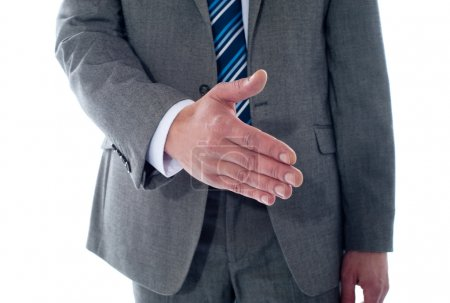 Photo for Business deal, close-up shot. Businessman offering handshake - Royalty Free Image