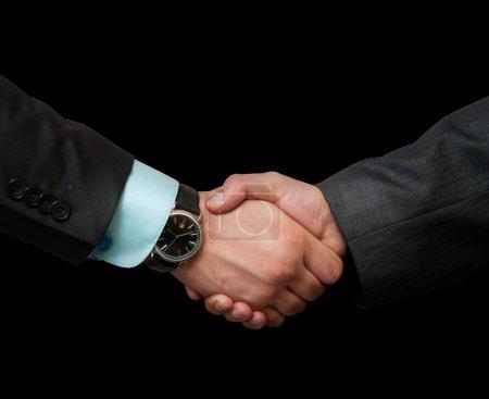 Photo pour Poignée de main, sur un fond noir - image libre de droit