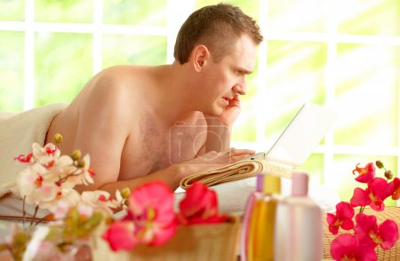 Photo for Even in spa business man is busy working using his laptop and phone. - Royalty Free Image