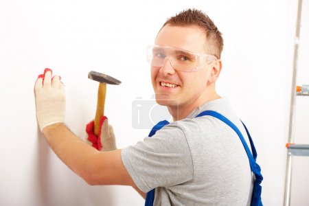 Man working with hammer