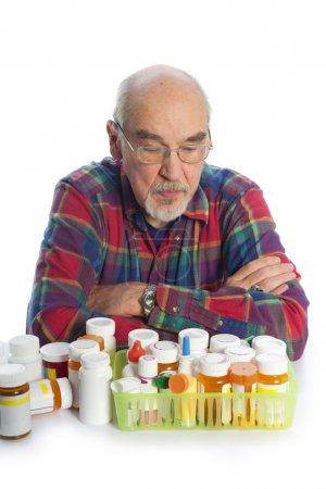 Senior man and medicine bottles