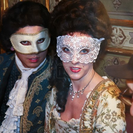 A masked couple in a cafe