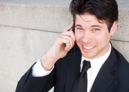 Photo for Portrait of handsome, young business man using cell phone, smiling - Royalty Free Image