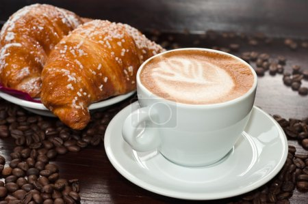 Photo for Cappuccino and croissant with coffee beans - Royalty Free Image