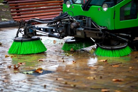 Photo for Sweeping machine picking the leaves of the trees - Royalty Free Image
