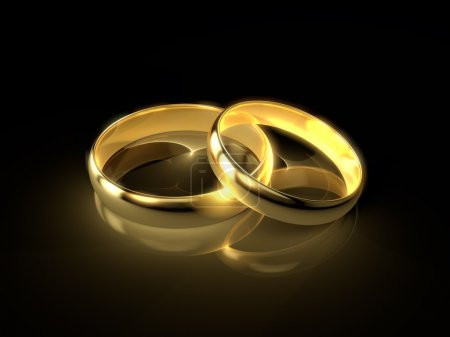 Photo for Two golden wedding rings isolated on black background. - Royalty Free Image