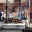 Nepalese at sad ceremony of cremation in the Templ...