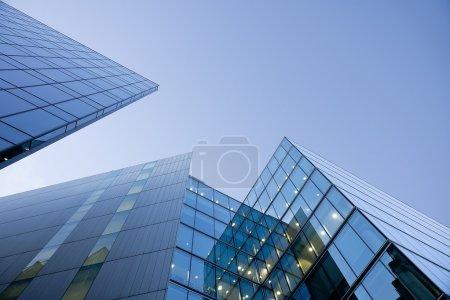 Blue glass buildings on blue sky