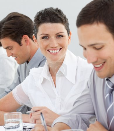 Attractive businesswoman in a meeting with her team