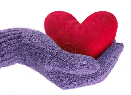 Heart in hand in blue glove