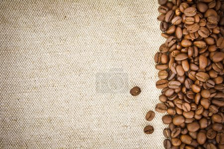 Photo for Coffee Beans on Burlap, Hessian, Sacking Background - Royalty Free Image