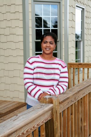 Woman Standing on Her Deck