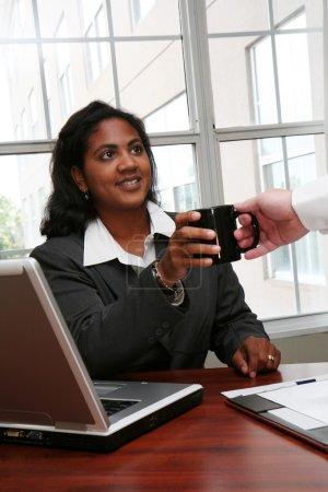 Businesswoman Getting Coffee