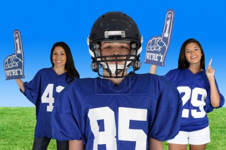 Photo for Football Player with fans cheering for him - Royalty Free Image