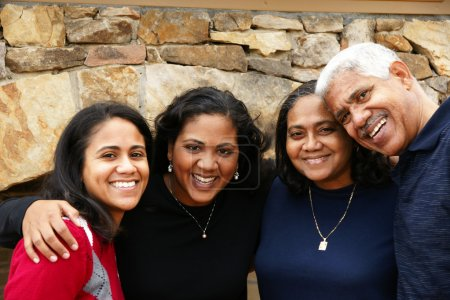 Photo for Minority family in their new home - Royalty Free Image