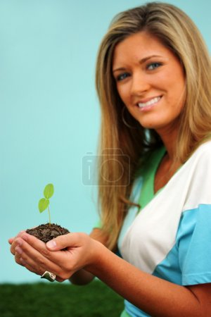 Photo for Woman Holding A New Plant In Dirt - Royalty Free Image