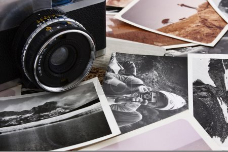 Photo for Several stack of antique photos and old camera - Royalty Free Image