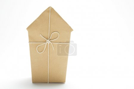Photo for Studio Shot Of Model House Wrapped In Brown Paper And Tied With String - Royalty Free Image