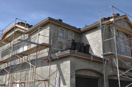 New Stucco Home Under Construction with Blue Sky B...