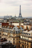 Eiffel tower over the roofs