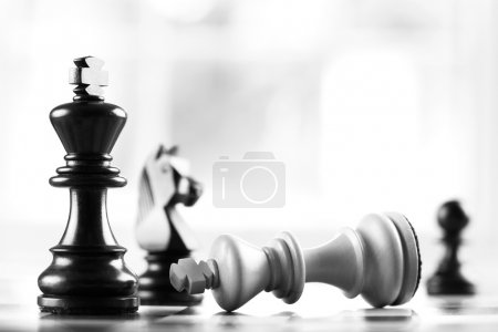 Photo for Checkmate black defeats white king selective focus - Royalty Free Image