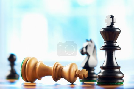 White king wins chess game sepia tone