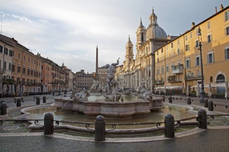 Rome - Piazza Navona in morning and Fountain of Neptune (1574) created by Giacomo della Porta and Santa Agnese in Agone church