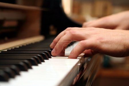 Photo for Hands of a piano playing guy in a sensitive mood - Royalty Free Image