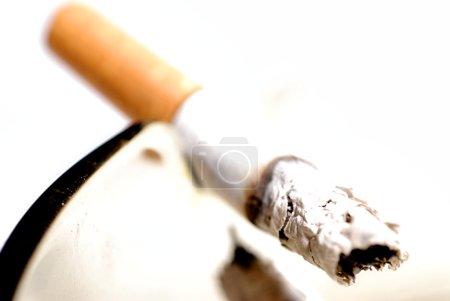 Picture of half burned cigarette in ash tray....
