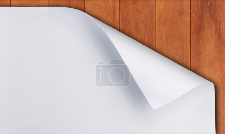 Paper curl on wood background