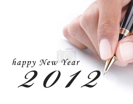 Photo pour Geste de main écrire bonne annee 2012 - image libre de droit