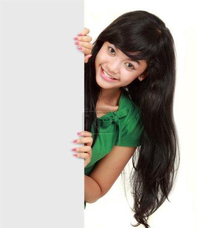 Girl holding big blank card