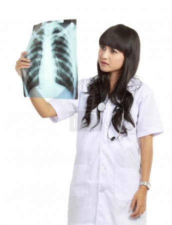 Female doctor examining an x-ray