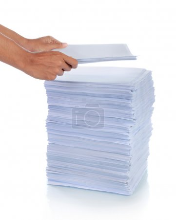 Hand put paper on stack of paper. with isolated ba...