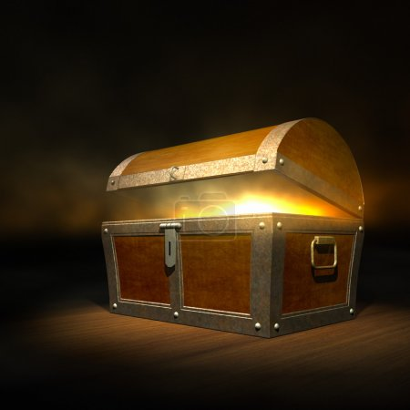 Photo for Old wooden treasure chest with strong glow from inside - Royalty Free Image