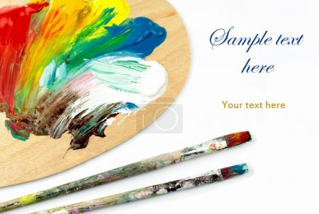 Artist palette , colors and paintbrushes