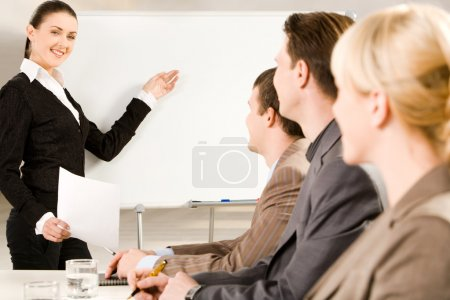 Photo for Businesswoman doing presentation on whiteboard at seminar - Royalty Free Image