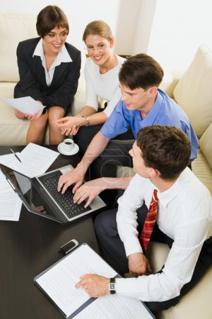 Group of business looking at monitor