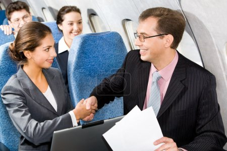 Handshake in a plane