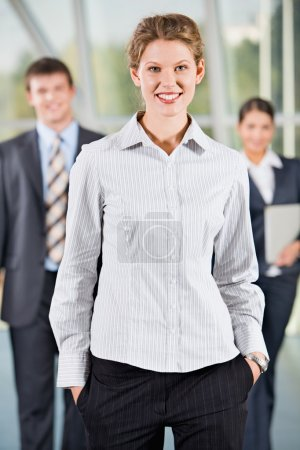 Photo for Female leader on the background of her business team - Royalty Free Image