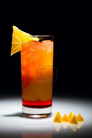 Photo for Campari orange cocktail with slice of orange isolated on the black background - Royalty Free Image