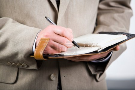 Photo for Photo of businessman holding the pen and notepad - Royalty Free Image